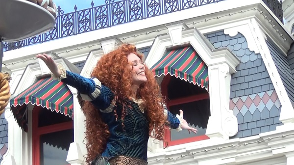 festival of fantasy magic kingdom disney world red head on front of boat