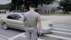 Sgt Richard Ruth radios to  a group of cops down the street as cars go by Him that never see Him. Why would someone drive looking to the curb?